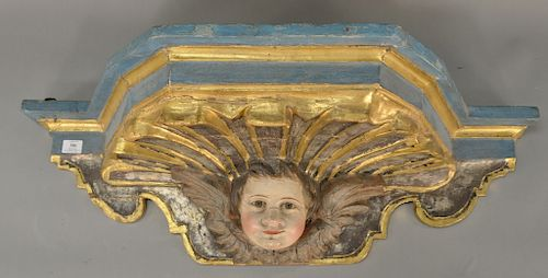 Carved polychrome shelf,  having putti face with gilt highlights.  height 12 inches, width 38 1/2 inches, depth 14 inches