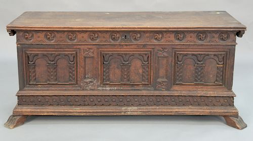 Walnut cassone having lift-top with paneled and carved front on four feet, 17th - 18th century