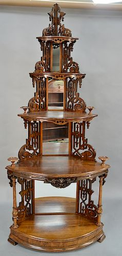 Victorian rosewood corner etagere with pierced carved supports and mirror corners.  height 93 1/2 inches, width 40 inches, depth 24 ...