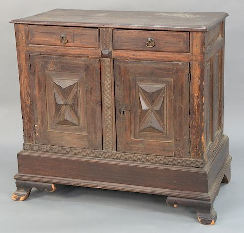 Italian walnut cabinet with two drawers over two doors,  on plain base with ogee feet, raised panel back and sides, probably Italian...