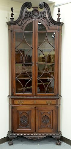 Pair of mahogany two part corner cabinets,  carved broken arch tops over double arch top doors, on lower section with one drawer and...