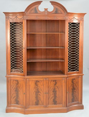 Margolis mahogany breakfront in two parts,  upper section with pediment top over swag carved panel with four shelves flanked by gril...