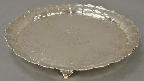 Paul de Lamerie (1688-1751) silver fruit dish having raised scalloped edge with shell and thatched chasing, set on four scrolled fee...