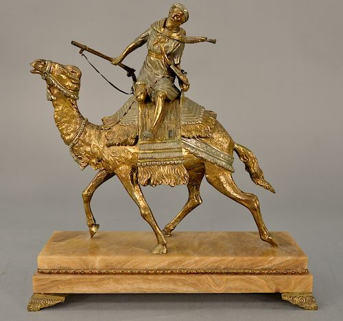 Orientalist Austrian bronze figure,  Camel Rider holding rifle.  height 12 3/4 inches, length 12 1/2 inches