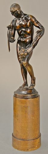 Figural statue of a nude man holding a bouquet of flowers and a bird standing on round base, marked on back of base: DaLou.  bronze ...