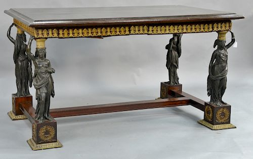 Classical French Empire style writing table,  two drawers on two pairs of bronze caryatids mounted on square mahogany bases with gil...