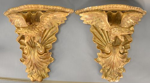 Pair of carved giltwood and gesso eagle bracket shelves,  each with spreading eagle rocaille and acanthus carving, 19th century (rep...