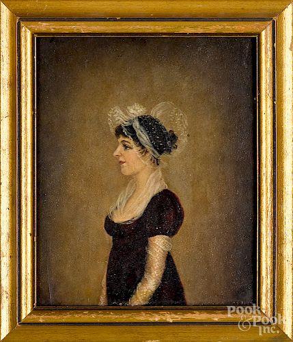 Pair of oil on slate profile portraits