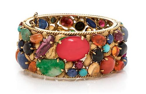 An 18 Karat Yellow Gold and Multigem Bangle Bracelet, 54.25 dwts.