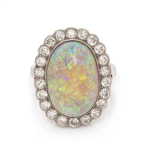 A Platinum, Opal and Diamond Ring, 3.85 dwts.