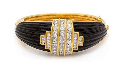 An 18 Karat Yellow Gold, Diamond and Onyx Bangle Bracelet, Montreaux, 69.45 dwts.