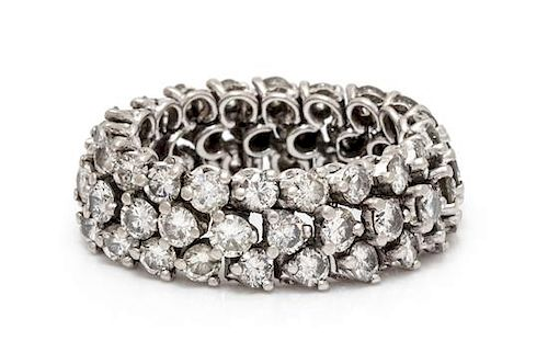A Platinum and Diamond Flexible Band Ring, 5.77 dwts.