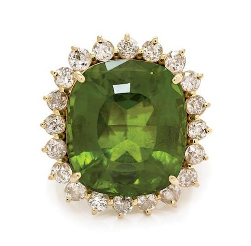A 14 Karat Yellow Gold, Peridot and Diamond Ring, 11.95 dwts.
