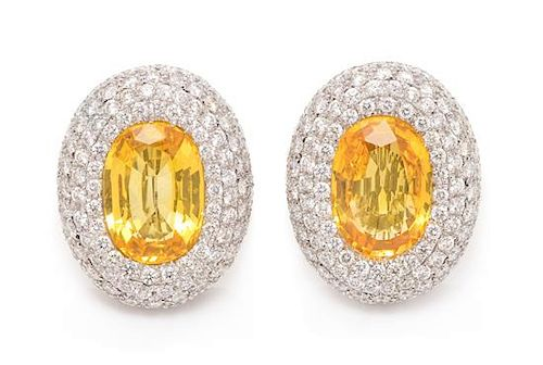 A Pair of 18 Karat White Gold, Yellow Sapphire and Diamond Earclips, Michele della Valle, 18.80 dwts.