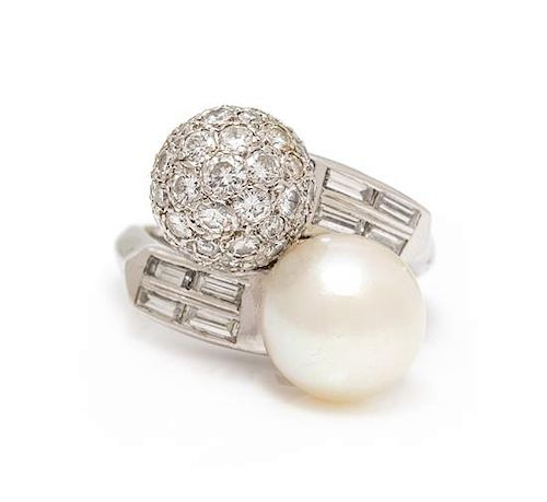 A Platinum, Cultured Pearl and Diamond 'Toi et Moi' Ring, 6.75 dwts.