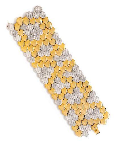 An 18 Karat Bicolor Gold and Diamond Scale Motif Bracelet, 125.90 dwts.