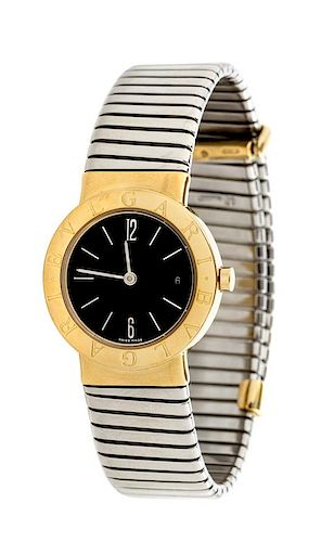 An 18 Karat Yellow Gold and Stainless Steel Ref. BB 26 GSCD 'Tobago' Bangle Watch, Bvlgari,