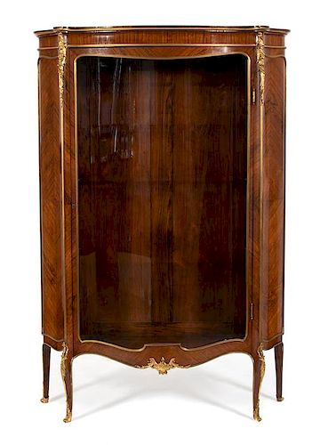 A Louis XV Style Gilt Bronze Mounted Kingwood Serpentine Vitrine Cabinet Height 70 x width 47 x depth 14 inches.