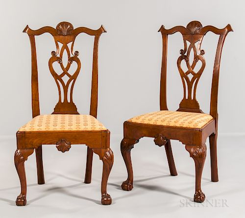 Pair of shell carved walnut side chairs by skinner