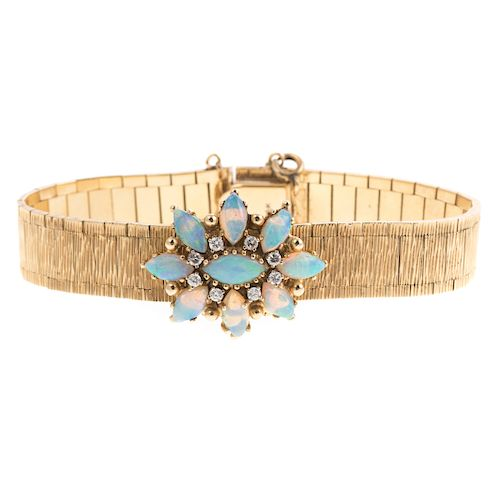 A Ladies Opal & Diamond Covered Watch by Geneve