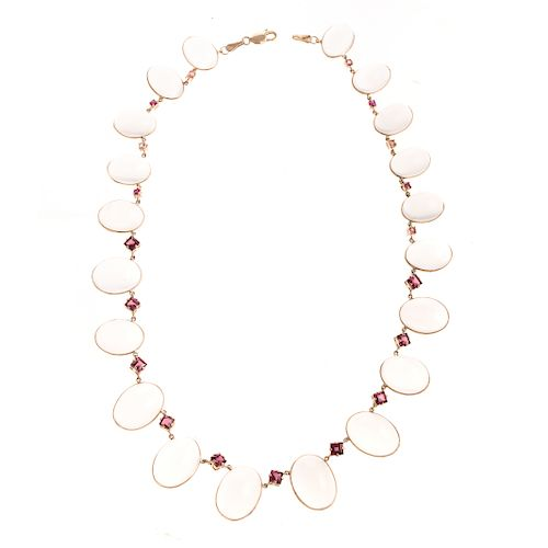 A Graduated Moonstone & Ruby Station Necklace