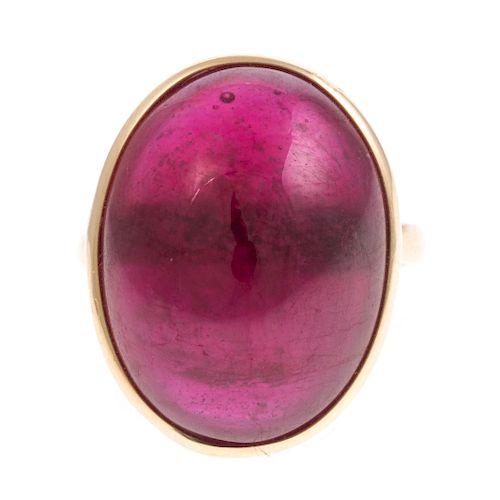A Ladies Cabochon Ruby Ring in 14K