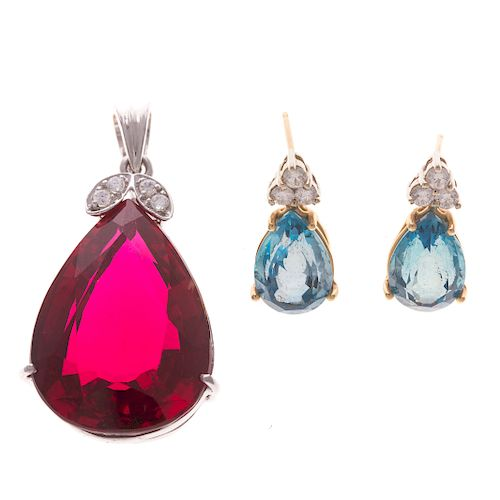 A Ladies Gemstone Earrings and Pendant in Gold