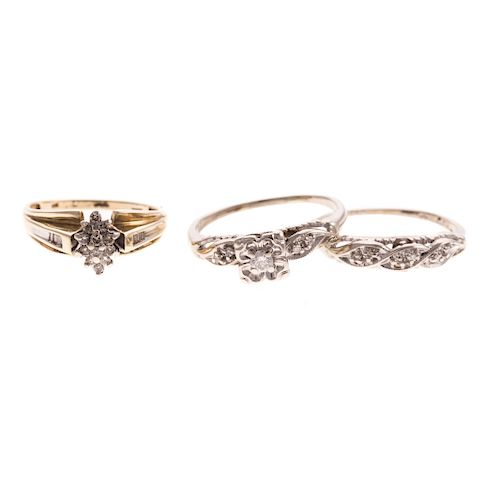 A Trio of Diamond Engagement Rings & Bands in Gold