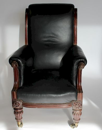 Antique Leather Upholstered High back Arm Chair.