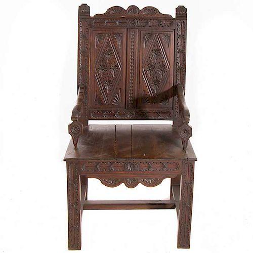 """Sillón. Francia. Siglo XX. En talla de madera de roble. Chambrana en """"H"""" y soportes lisos."""
