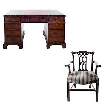 Escritorio y sillón. Siglo XX. En talla de madera de caoba. Escritorio con cubierta rectangular, 9 cajones y soportes lisos.