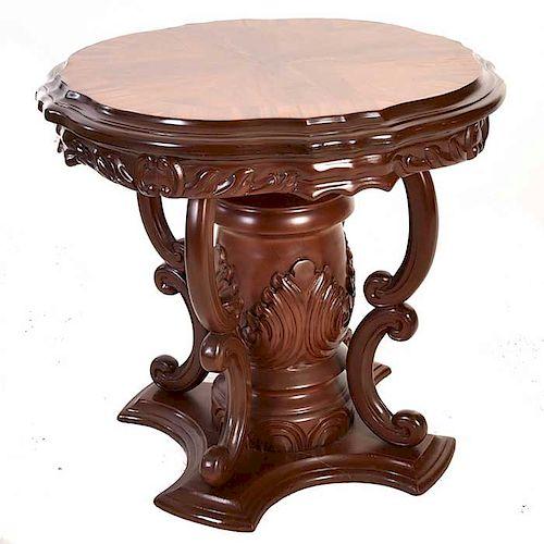 Mesa auxiliar. Siglo XX. En talla de madera enchapada. Con cubierta circular, fuste tipo jarrón y soporte tipo zócalo.