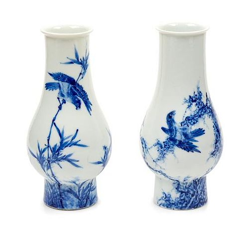 Two Blue and White Porcelain Vases Height 7 inches.