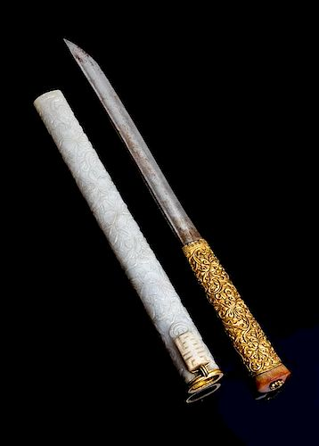 A Gilt Bronze Handled Dagger with White Jade Scabbard Length overall 12 1/4 inches.