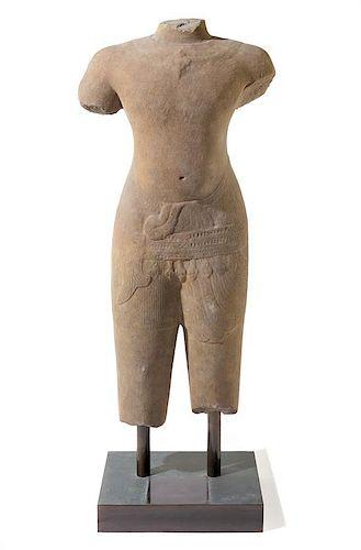 * A Khmer Baphuon-Style Limestone Torso of Vishnu Height 43 inches.