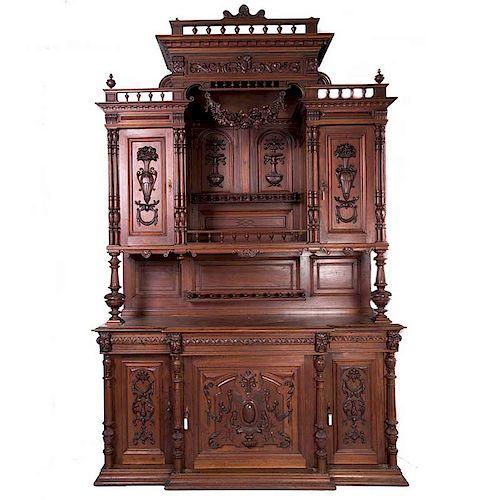 Buffet. Francia. Siglo XX. En talla de madera. A 2 cuerpos. Con 5 puertas, 3 cajones, fustes de jarrón, compuestos y sopor...