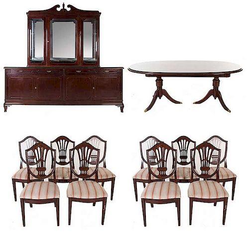 Comedor. Siglo XX. En talla de madera. Con aplicaciones de metal dorado. Consta de Mesa, 10 sillas y vitrina.