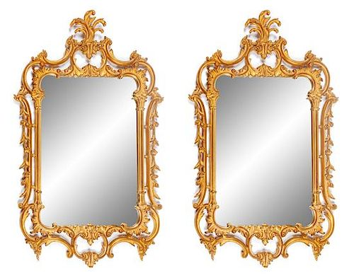 A Pair of Louis XV Style Gilt Mirrors Height 50 x width 29 inches.