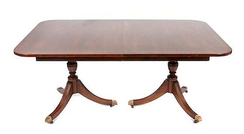 * A Regency Style Mahogany Extension Table Height 28 3/4 x width 80 x depth 46 inches.
