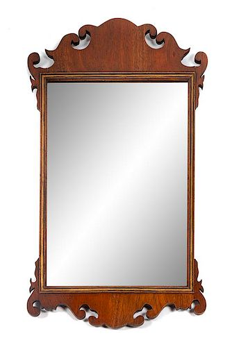 * A Chippendale Style Parcel Gilt Mahogany Tablet Mirror Height 33 1/4 x width 19 inches.