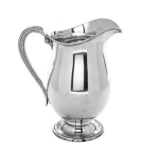 * An American Silver Pitcher, International Silver Co., Meriden, CT, with reeded handle.