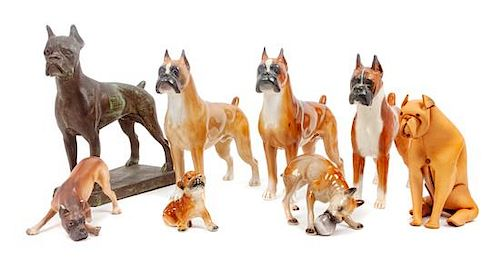 * A Group of Eight Boxer Figurines Height of tallest 9 3/4 inches.