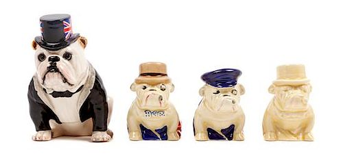 * A Group of Four Royal Doulton Bulldogs Height of tallest 5 inches.