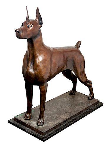 * A Bronze Doberman Pinscher Sculpture Height 44 x width 41 x depth 17 3/4 inches.