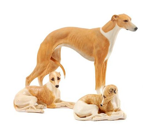 * A Group of Three Ceramic Greyhounds Width of widest 9 1/2 inches.