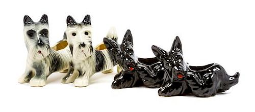 * Four Scottish Terrier Planters Width of widest 8 1/2 inches.
