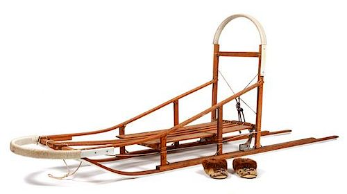 * A Dog Sled and a Pair of Eskimo Shoes Length of sled 106 inches.