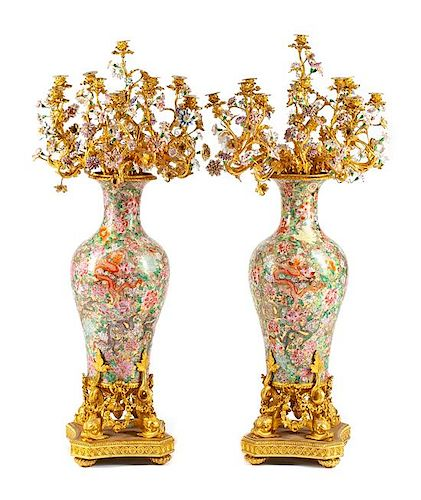 A Pair of Monumental French Gilt Bronze and Porcelain Mounted Candelabra Height 54 inches.