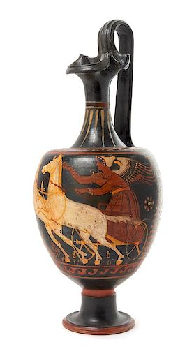 * An Apulian Red Figured Pottery Oinochoe Height 16 inches.