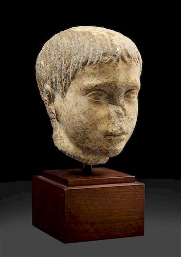 A Roman Marble Head of a Youth Height 8 inches.